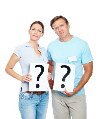Portrait of a mature couple standing with question marks against white